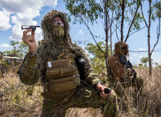 Australian Army soldier, Private Matt Wood, prepares to launch a PD-100 Black Hornet Nano unmanned aircraft vehicle during Land Trial 02-18 at the Townsville Field Training Area in North Queensland.