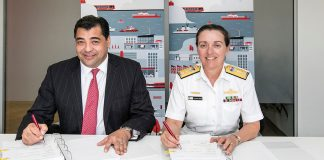 Serco Asia Pacific Chief Executive Mark Irwin and Royal Australian Navy Commodore Stephanie Moles.