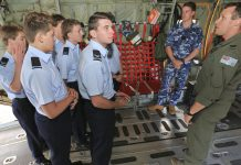 Loadmaster, Sergeant Adam Roberts, with the help of Avionic Technician Jerry Dilger, shows the Cadets through the C-130J interior during the visit.