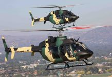 Bell 407, VH-BLE, and Bell 429, VH-MJI, wearing an Australian military camouflage scheme ahead of the 2019 Australian International Airshow. Both helicopters are captured within the vicinity of Albury, New South Wales.